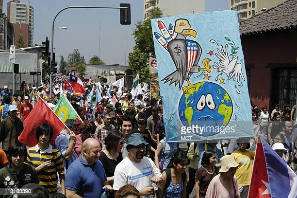 SANTIAGO CHILE According to radio accounts000 people marched against President George Bush the war in Iraq and globalization on the first day of the...