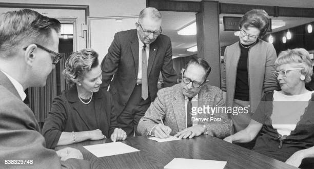Account Opened for New Auditorium Virgil Bruns left vice president of the First National Bank of Westminster watches as Mrs Herbert Smith Carroll...