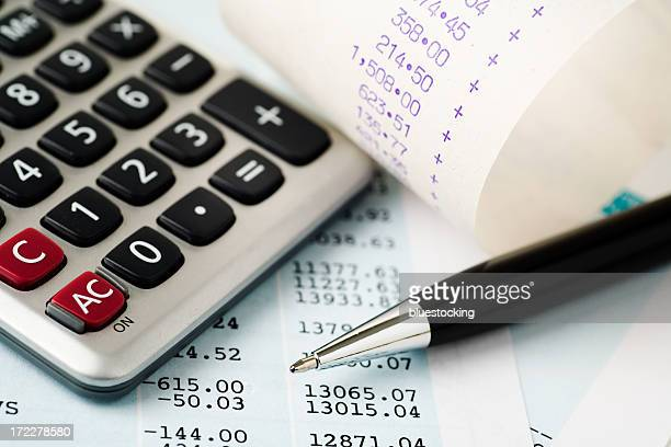 Account plans with a calculator and pen