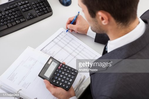 Accountant working at the office : Stock Photo