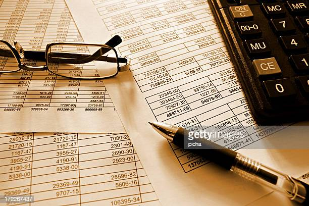 Accountant working with numbers and finance with calculator