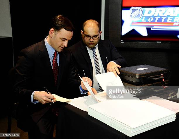 Accountants from Ernst and Young calculate the numbers at he National Hockey League Draft Lottery on April 18 2015 at the Sportsnet Studios in...