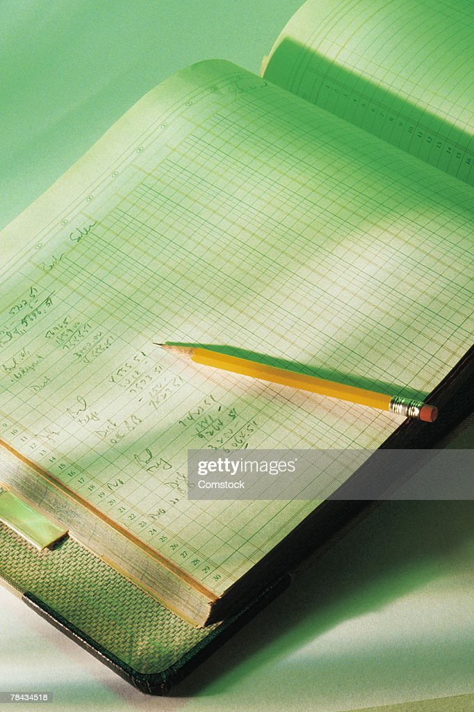 Accounting ledger and pencil