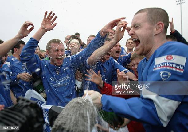 Accrington Stanley players celebrate promotion to the Football League after the Nationwide Conference match between Woking and Accrington Stanley at...