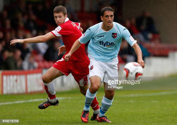 Accrington Stanley's Craig Lindfield in action with Exeter City's Craig Woodman during the npower Football League Two match at the Crown Ground...