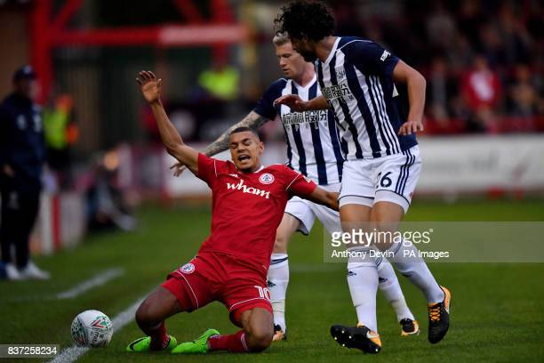 Accrington Stanley's Kayden Jackson is tackled by West Bromwich Albion's Ahmed Hegazi during the Carabao Cup Second Round match at the Wham Stadium...