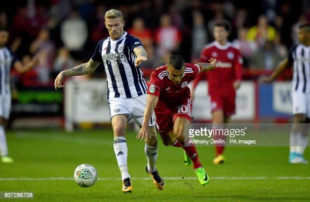 Accrington Stanley's Kayden Jackson is tackled by West Bromwich Albion's James McClean during the Carabao Cup Second Round match at the Wham Stadium...