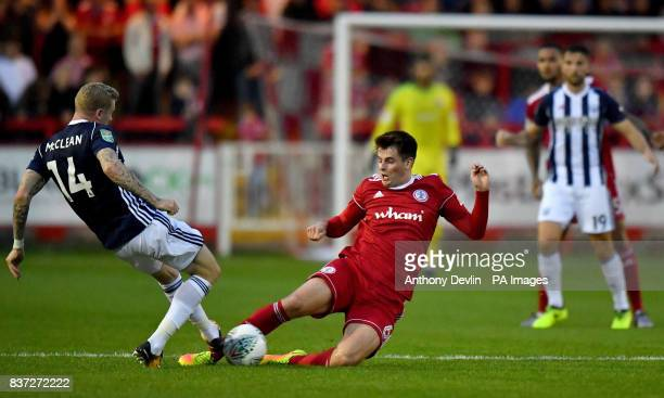 Accrington Stanley's Liam Nolan is tackled by West Bromwich Albion's James McClean during the Carabao Cup Second Round match at the Wham Stadium...