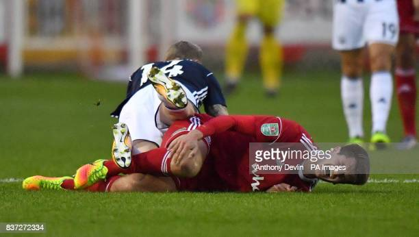 Accrington Stanley's Liam Nolan reacts following a tackle by West Bromwich Albion's James McClean during the Carabao Cup Second Round match at the...