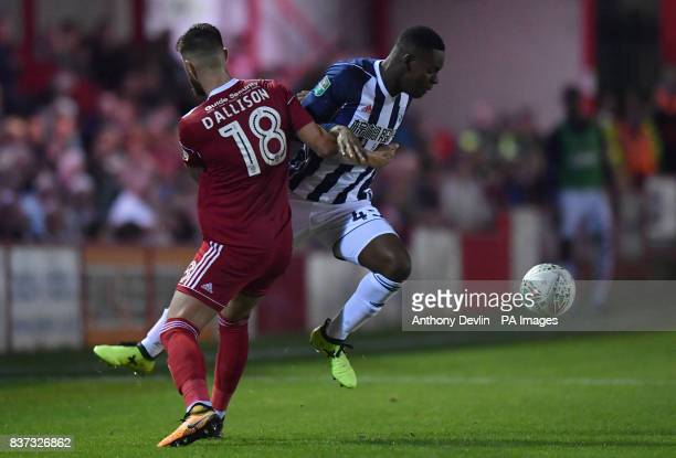Accrington Stanley's Tom Dallison and West Bromwich Albion's Jonathon Leko in action during the Carabao Cup Second Round match at the Wham Stadium...