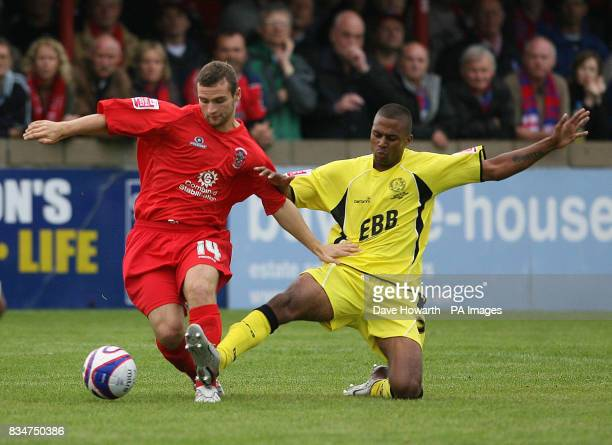 Accrington's James Ryan and Aldershot's Louie Soares during the CocaCola Football League Two match at the Fraser Eagle Stadium Accrington