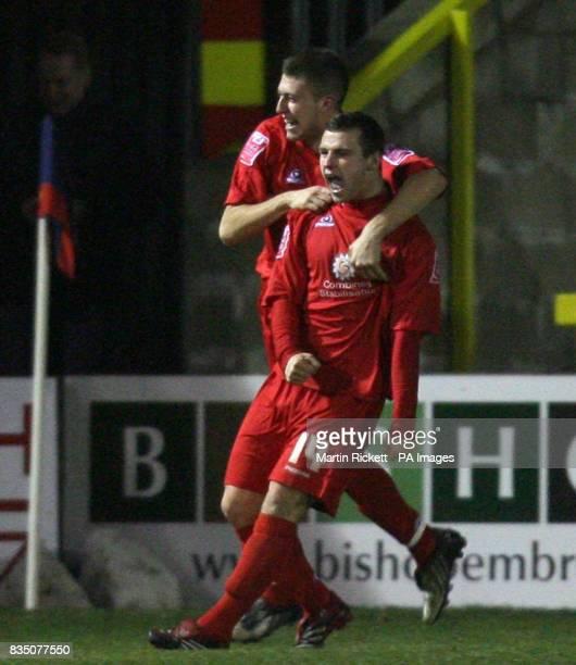 Accrington's James Ryan celebrates his goal with Kieran Charnock during the CocaCola League Two match at the Fraser Eagle Stadium Accrington