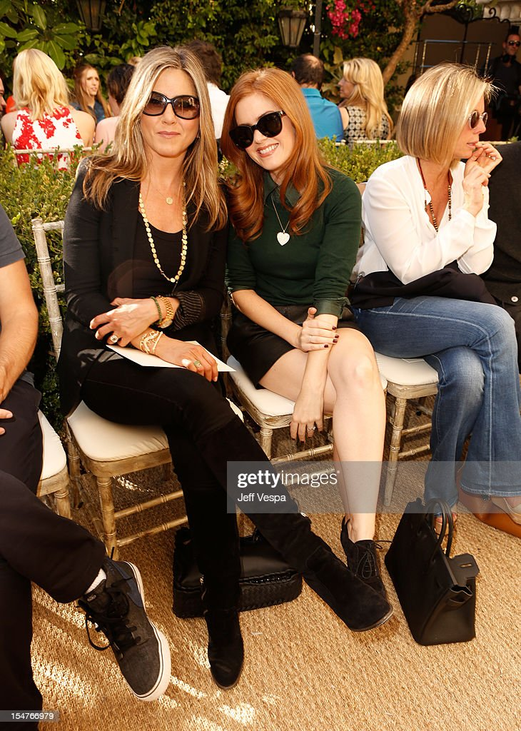 Acctors Jennifer Aniston and Isla Fisher attend CFDA/Vogue Fashion Fund Event hosted by Lisa Love and Mark Holgate and sponsored by Audi, Beauty.com, American Express, and J Brand at Chateau Marmont on October 25, 2012 in Los Angeles, California.