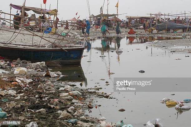 Accumulated garbage on the river bank of Ganga on the eve of Environment Day in Allahabad