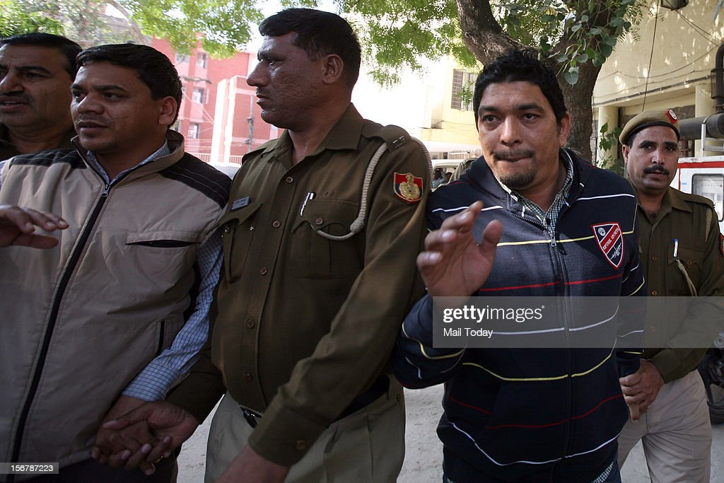 Accused in Ponty Chadha andHardeep Chadha murder case being brought out of Mehrauli police station.