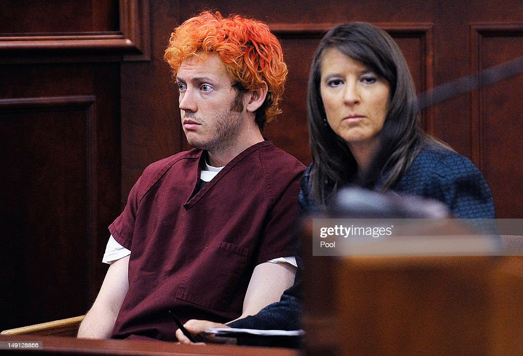 Accused movie theater shooter James Holmes (L) makes his first court appearance at the Arapahoe County Courthouse with his public defender Tamara Brady on July 23, 2012 in Centennial, Colorado. According to police, Holmes killed 12 people and injured 58 others during a shooting rampage at an opening night screening of 'The Dark Knight Rises' July 20, in Aurora, Colorado.