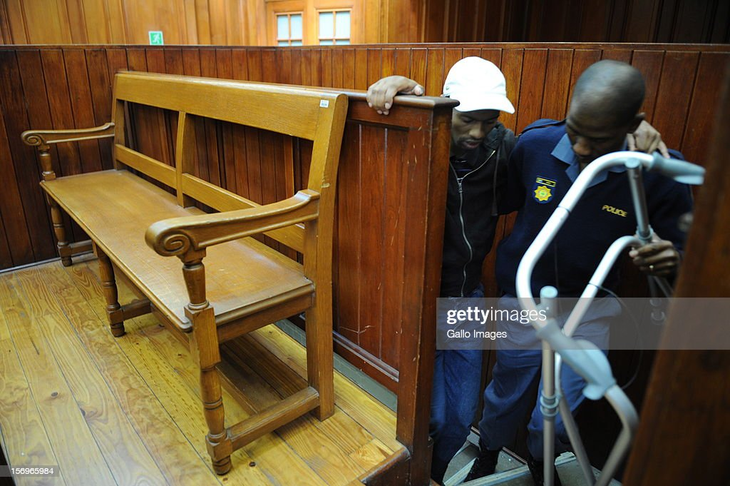 Accused murderer Xolile Mngeni enters Cape Town High Court on November 26, 2012 in Cape Town, South Africa. Mngeni was found guilty of robbery with aggravating circumstances, premeditated murder and illegal possession of a firearm and ammunition, after his involvement with the murder of Anni Dewani.