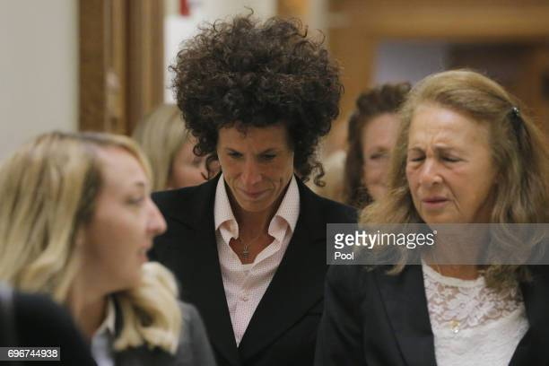 Accuser Andrea Constand reacts after leaving the courtroom following the fifth day of deliberations in Bill Cosby's sexual assault trial at the...