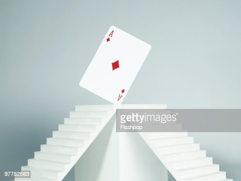 Ace card balancing on plinth : Stock Photo