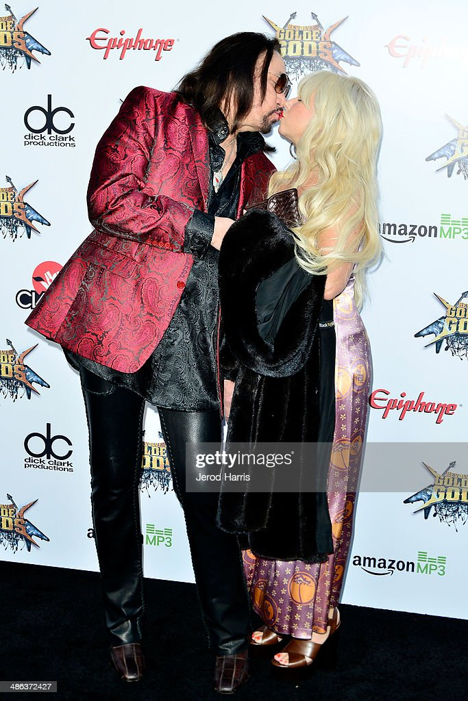 <a gi-track='captionPersonalityLinkClicked' href=/galleries/search?phrase=Ace+Frehley&family=editorial&specificpeople=226761 ng-click='$event.stopPropagation()'>Ace Frehley</a> and wife Jeanette Trerotola kiss at the 2014 Revolver Golden Gods Awards at Club Nokia on April 23, 2014 in Los Angeles, California.