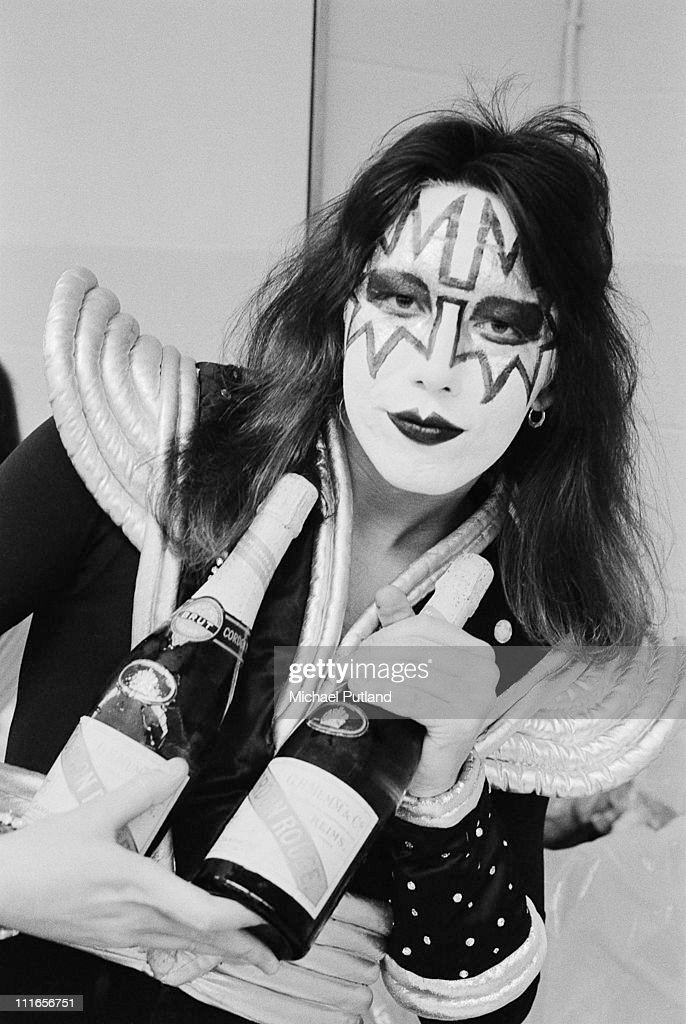 Ace Frehley of Kiss, portrait, backstage in dressing room in stage make up, holding bottle of champagne, New York, February 1977.