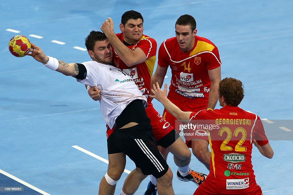 Ace Jonovski (2nd L), Velko Markoski (3rd L) and Goce Georgievski of Macedonia defend against Christoph Theuerkauf of Germany (2nd L) during the round of sixteen match between Germany and Macedonia at Palau Sant Jordi on January 20, 2013 in Barcelona, Spain.