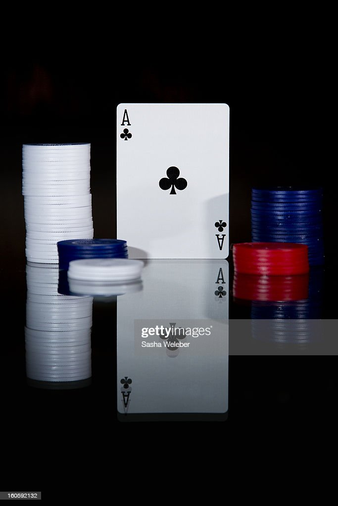Ace of clubs playing card with poker chips : Stock Photo