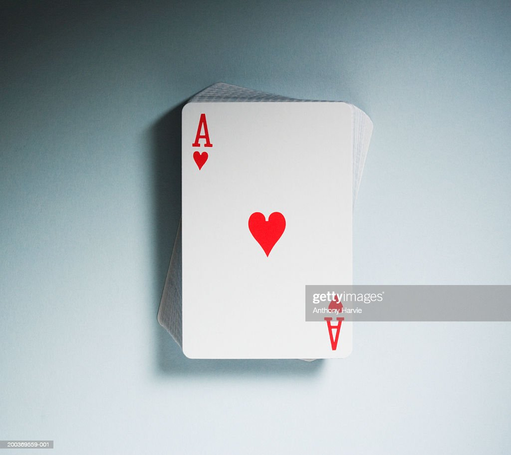 Ace of Hearts on top of pack of playing cards, close-up : Stock Photo