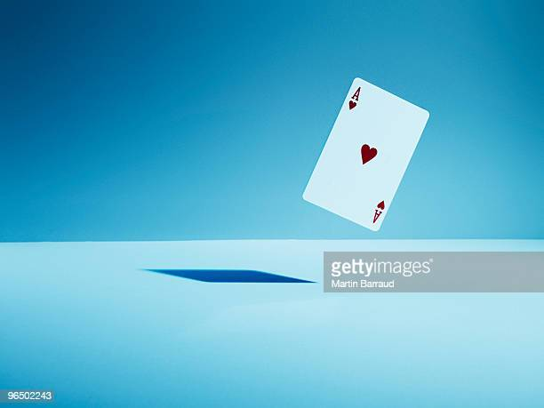 Ace of hearts playing card in mid-air