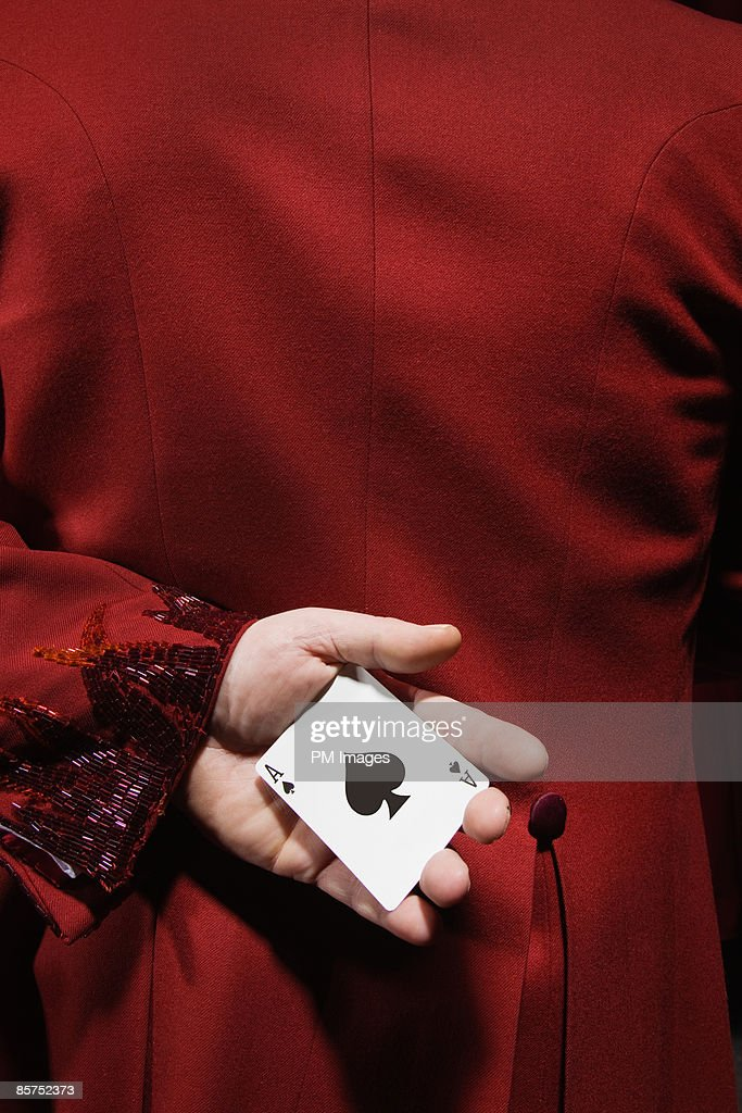 Ace of spades behind his back. : Stock Photo