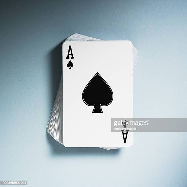 Ace of Spades on top of pack of playing cards, close-up, elevated view