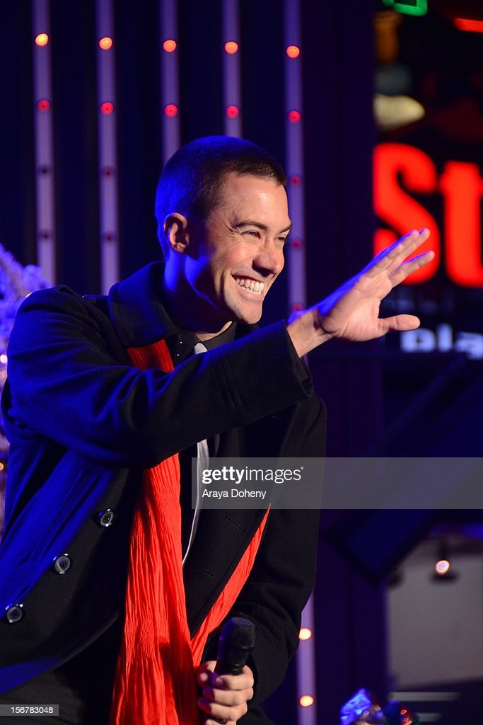 <a gi-track='captionPersonalityLinkClicked' href=/galleries/search?phrase=Ace+Young&family=editorial&specificpeople=540262 ng-click='$event.stopPropagation()'>Ace Young</a> performs at the 2012 Hollywood Christmas Parade Concert at Universal CityWalk on November 20, 2012 in Universal City, California.