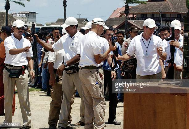 Aceh Monitoring Mission members receive Free Aceh Movement's weapons during a disarmament ceremony in Banda Aceh 15 September 2005 Separatist rebels...
