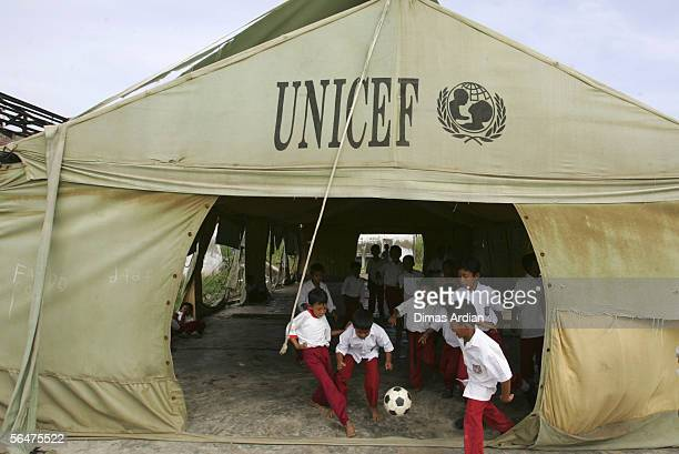Acehnese elementary school students play soccer at a temporary 'tent school' provided by UNICEF on December 21 2005 in Banda Aceh Indonesia...