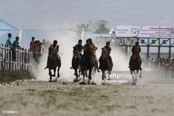 Acehnese teens compete during the annual traditional horse race in Takengon Central Aceh Indonesia February 19 2014 Horse racing is an annual event...