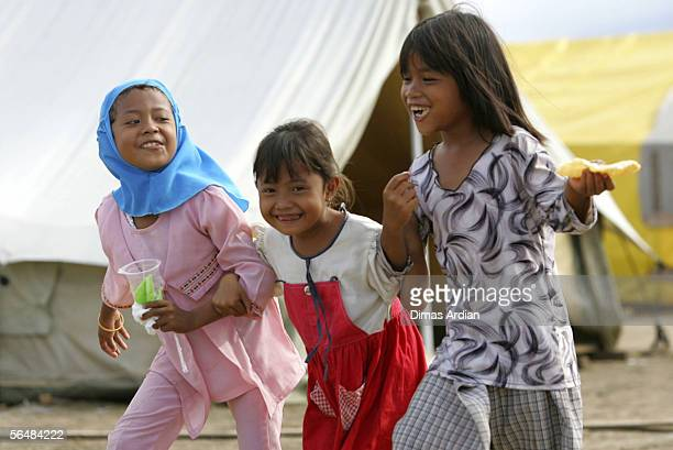 Acehnese tsunami survivor children play outside their 'tent home' December 23 2005 in Banda Aceh IndonesiaIndonesia's Rehabilitation and...