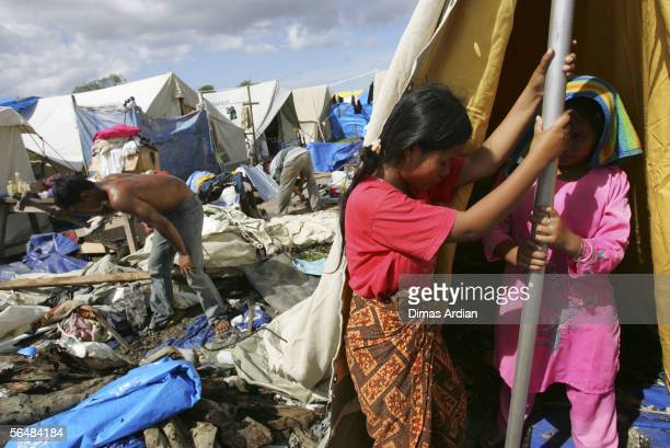 Acehnese tsunami survivors rebuild their 'tent home' after it was accidentally burnt December 23 2005 in Banda Aceh Indonesia Indonesia's...