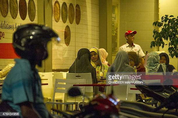 Acehnese women eat at a restaurant in Banda Aceh on June 9 2015 Women in the Indonesian city of Banda Aceh have been banned from venues like cafes...