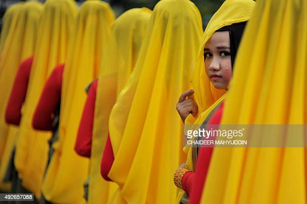 Acehnese women wearing colorful costumes take part in the celebrations of the Islamic New Year in Banda Aceh capital of Indonesia's conservative...