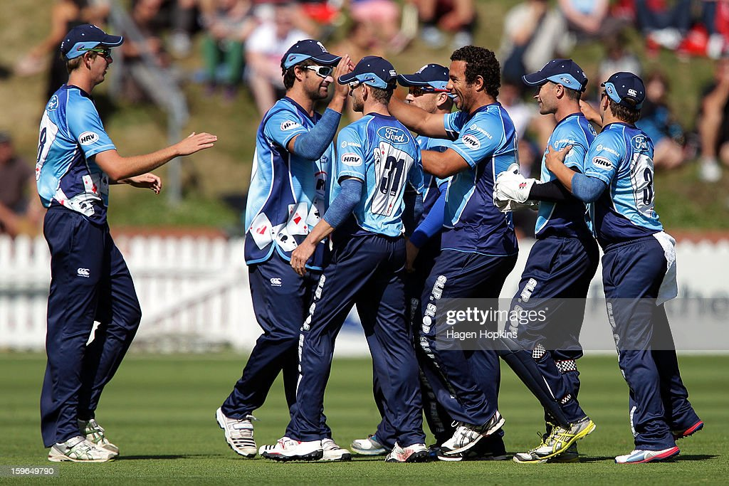 Aces players celebrate the wicket of Ben Orton of Wellington during the HRV Cup Twenty20 Preliminary Final between the Wellington Firebirds and the Auckland Aces at Basin Reserve on January 18, 2013 in Wellington, New Zealand.