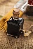 Aceto Balzamico di Modena in small glass bottle; close up,