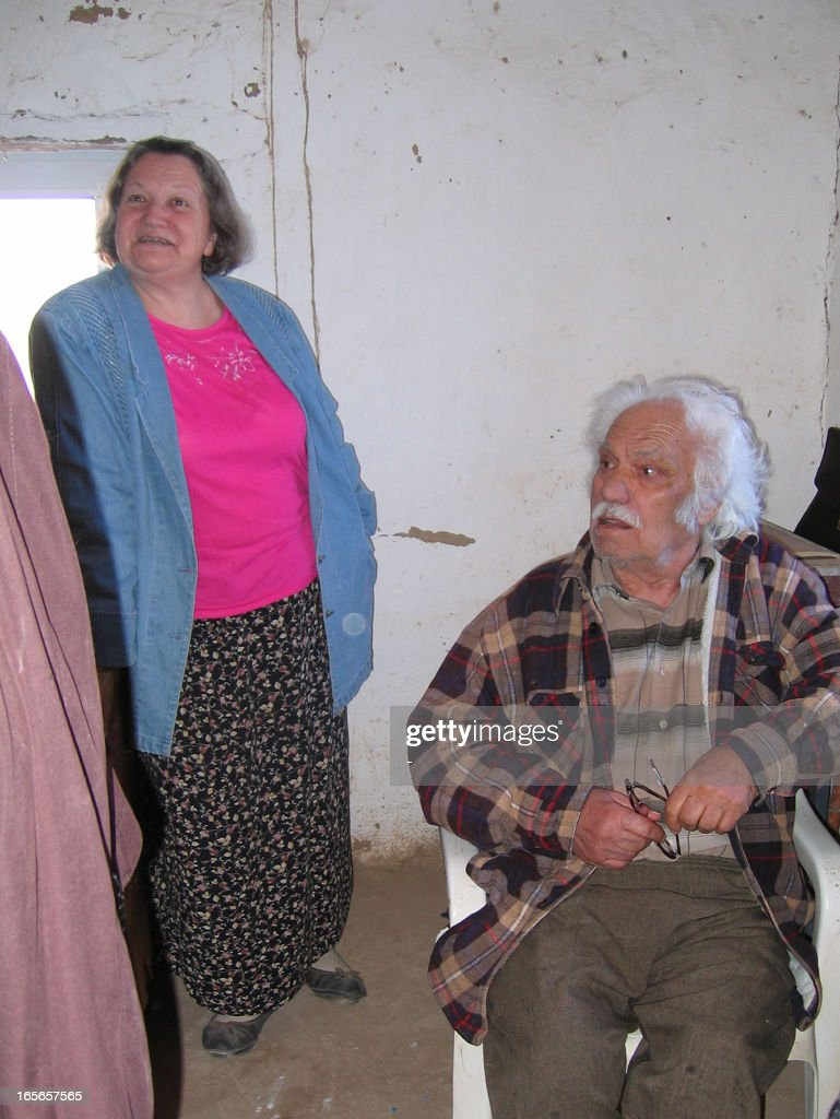 Acheologists (L-R) Nadezhda Dubova and Viktor Sarianidi speak to the AFP in the city of Mary in the Kara Kum desert in remote western Turkmenistan, on April 2, 2013. After being uncovered by Soviet archaeologist Viktor Sarianidi in the last century, the former fortress town of Gonur-Tepe is gradually revealing its mysteries to the world with new artifacts being uncovered on every summer dig.