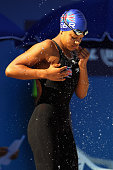 Achieng AjuluBushell of Great Britain covers herself in water prior to the start of her Women's 100m Breaststroke heat during the European Swimming...
