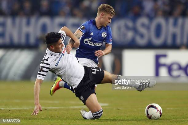 Achilleas Pouggouras of PAOK is challenged by Max Meyer of Schalke during the UEFA Europa League Round of 32 second leg match between FC Schalke 04...
