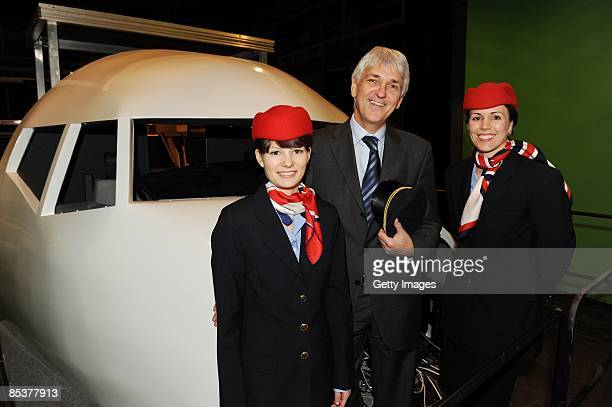 Achim Rohnke and air hostess Steffi and Ulli in front of the cockpit of Europe's largest airplane set at the Bavaria Film Studios on March 11 2009 in...