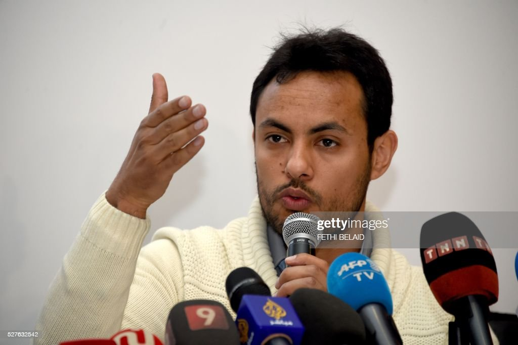 Achraf Aouadi, the director of the local youth-led, anti-corruption nongovernmental organisation 'I-Watch' (Ana Yakedh) gives a press conference in the capital Tunis, on May 3, 2016. A report by Transparency International stated that eight Arab countries, including the Palestinian territories, have seen an increase in corruption in the passed year, with an emphasis on the situation in Lebanon and political crisis in Yemen. / AFP / FETHI