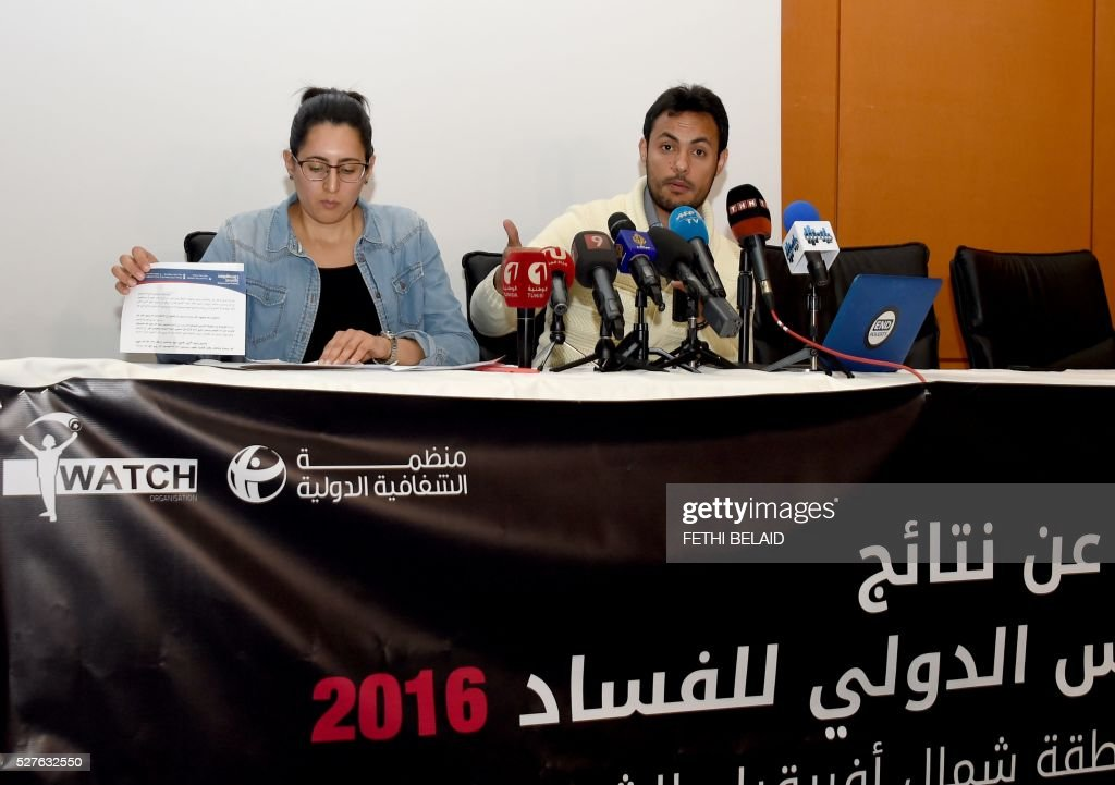 Achraf Aouadi (R), the director of the local youth-led, anti-corruption nongovernmental organisation 'I-Watch' (Ana Yakedh) and his colleague Henda Fellah give a press conference in the capital Tunis, on May 3, 2016. A report by Transparency International stated that eight Arab countries, including the Palestinian territories, have seen an increase in corruption in the passed year, with an emphasis on the situation in Lebanon and political crisis in Yemen. / AFP / FETHI