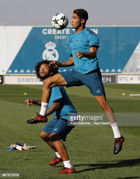 Achraf Hakimi and Marcelo of Real Madrid in action during a training session at Valdebebas training ground on October 16 2017 in Madrid Spain