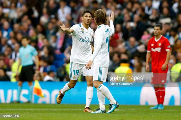 Achraf Hakimi of Real Madrid celebrates with teammate Luka Modric after scoring his team's fifth goal during the La Liga match between Real Madrid...