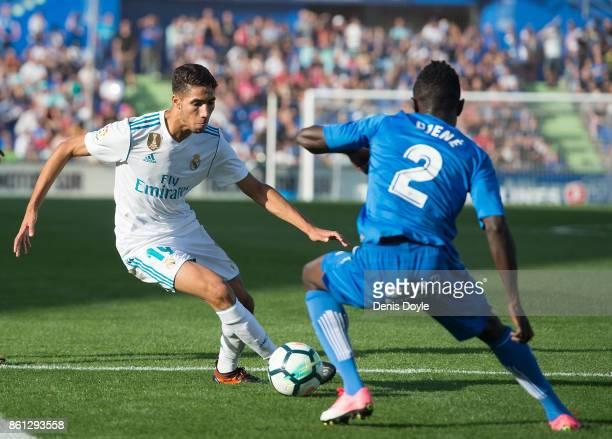 Achraf Hakimi of Real Madrid CF takes on Djene Dakonam Ortega of Getafe during the La Liga match between Getafe and Real Madrid at Coliseum Alfonso...